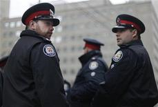 <p>Police officers gather at a downtown police station prior to a funeral for Toronto Police Sgt. Ryan Russell in Toronto, January 18, 2011. REUTERS/Mark Blinch</p>