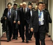 <p>Greece's Prime Minister George Papandreou (C) arrives at a news conference at the end of a euro zone summit in Brussels, October 27, 2011. REUTERS/Yves Herman</p>