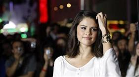 """<p>Actress and singer Selena Gomez poses at the world premiere of """"The Thing"""" at Universal Studios Hollywood in Universal City, California October 10, 2011. The movie opens in the U.S. on October 14. REUTERS/Mario Anzuoni</p>"""