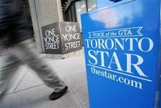 <p>A pedestrian walks past a Toronto Star newspaper box in front of the Toronto Star building at One Yonge Street in Toronto January 18, 2008. REUTERS/Mark Blinch</p>