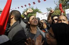 "<p>A protester shouts ""We want justice!"" during a demonstration outside the parliamentary building in Tunis November 22, 2011. REUTERS/Zoubeir Souissi</p>"