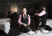 <p>Shan Jie poses for a portrait at her workplace, the Bloomsbury Radisson hotel in London November 24, 2011. Picture taken November 24, 2011. REUTERS/Olivia Harris</p>