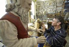 <p>Swiss artisan Francois Junod adjusts an element of his Leonardo da Vinci automaton project in his workshop in Sainte-Croix November 29, 2011. REUTERS/Denis Balibouse</p>