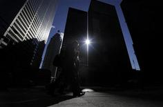 <p>Two men walk down the street from the King and Bay intersection in the financial district in Toronto February 22, 2011. REUTERS/Mark Blinch</p>