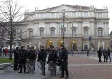"<p>Carabinieri policemen stand in front of La Scala opera house in Milan December 7, 2011. Mozart's ""Don Giovanni"", conducted by director Daniel Barenboim, will open for the 2011 opera season at the La Scala opera house. REUTERS/Alessandro Garofalo</p>"