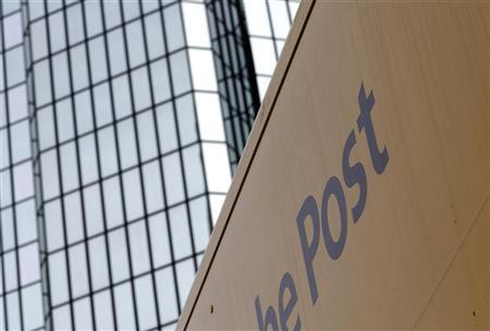 A post truck drives in front of the Deutsche Bank headquarters in Frankfurt December 8, 2011. REUTERS/Ralph Orlowski