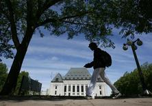 <p>A woman walks past the Supreme Court of Canada in Ottawa May 7, 2010. REUTERS/Chris Wattie</p>