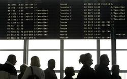 <p>People queue up under the information board indicating cancelled flights in a terminal at the Warsaw airport, April 16, 2010. REUTERS/Petr Josek</p>