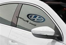 <p>The Volkwagen logo is seen reflected on the window of the newly-designed 2013 Volkswagen CC at the LA Auto Show in Los Angeles November 16, 2011. REUTERS/Danny Moloshok</p>