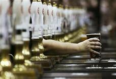 <p>A pint of beer is served through rows of beer pumps at the Campaign For Real Ale Great British Beer Festival at Earls Court in London August 2, 2011. REUTERS/Luke MacGregor</p>