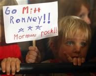 """<p>Three Year-old Dean Call holds a sign reading """"Go Mitt Romney Mormons Rock"""" as Romney speaks during a campaign rally in Columbia, South Carolina, January 11, 2012. REUTERS/Brian Snyder</p>"""