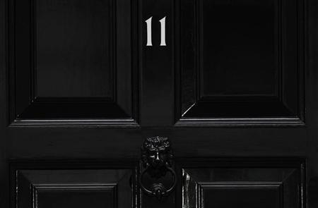 The front door of 11 Downing Street is seen in London November 29, 2011. REUTERS/Suzanne Plunkett