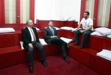 <p>Ahmed Alfi (L), Chairman of Sawari Ventures, Ramez Mohamed, CEO of Flat6Labs and Ahmed Essam (R) CEO of F16Apps, talk while posing for a picture during an open day at Flat6Labs headquarters in Cairo, January 16, 2012. REUTERS/Asmaa Waguih</p>