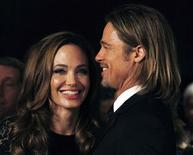 """<p>Actress Angelina Jolie smiles with her partner Brad Pitt as they arrive at the 23rd annual Producers Guild Awards in Beverly Hills, California, January 21, 2012. Jolie, who directed and produced the film """"In The Land of Blood and Honey"""", and other producers of the film received the Stanley Kramer Award at the event. REUTERS/Fred Prouser</p>"""
