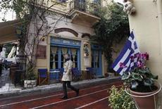 <p>A man walks in front of a cafe at Plaka tourist district in Athens January 24, 2012. REUTERS/John Kolesidis</p>