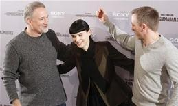 """<p>Cast members Daniel Craig (R) and Rooney Mara pose with director David Fincher (L) during the media presentation of their movie """"The Girl with the Dragon Tattoo"""" in Madrid January 4, 2012. REUTERS/Andrea Comas</p>"""