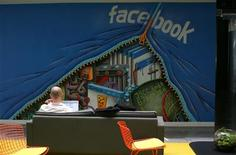 <p>An employee works on a computer at the new headquarters of Facebook in Menlo Park, California January 11, 2012. REUTERS/Robert Galbraith</p>