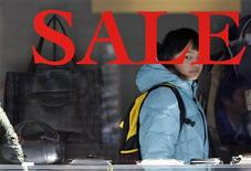 <p>A woman looks at bags displayed inside a shop in Tokyo January 27, 2012. REUTERS/Toru Hanai</p>