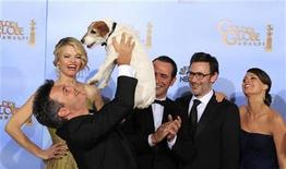 "<p>Thomas Langmann, producer of ""The Artist"", winner of best comedy or musical motion picture at the 69th annual Golden Globe Awards, holds Uggie the dog aloft in the photo room in Beverly Hills, California, January 15, 2012. Also pictured are cast members Missi Pyle (L), Jean Dujardin (C) and Berenice Bejo (R) and director Michel Hazanavicius. REUTERS/ Lucy Nicholson</p>"