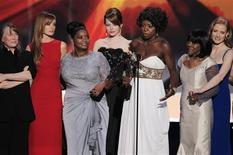 """<p>The cast of """"The Help"""" accept the award for outstanding performance by a cast in a motion picture at the 18th annual Screen Actors Guild Awards in Los Angeles, California January 29, 2012. REUTERS/Lucy Nicholson</p>"""