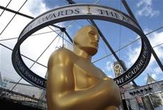 <p>An Oscar statue is seen beneath plastic sheeting during preparations for the 83rd Academy Awards in Hollywood, California February 26, 2011. REUTERS/Lucy Nicholson</p>