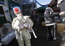 <p>Members of United Kennel Club Japan (UKC Japan) care for pets which are rescued from inside the exclusion zone around the crippled Fukushima Daiichi nuclear power plant, at the group's pet shelter in Samukawa town, Kanagawa prefecture January 25, 2012. Dogs and cats that were abandoned in the Fukushima exclusion zone after last year's nuclear crisis have had to survive high radiation and a lack of food, and they are now struggling with the region's freezing winter weather. A 9.0-magnitude earthquake and massive tsunami on March 11 triggered the world's worst nuclear accident in 25 years and forced residents around the Fukushima Daiichi nuclear power plant to flee, with many of them having to leave behind their pets. REUTERS/Issei Kato</p>
