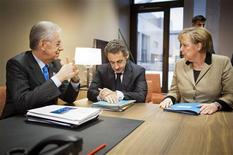 <p>Germany's Chancellor Angela Merkel meets with France's President Nicolas Sarkozy and Italy's Prime Minister Mario Monti shortly before an informal meeting of the European Council ahead of the European Union leaders summit in Brussels January 30, 2012. REUTERS/Bundesregierung/Jesco Denzel/Pool</p>