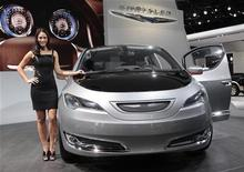 <p>Model Tiffany Stone stands next to the Chrysler 700 C concept van as it is displayed on the final press preview day for the North American International Auto Show in Detroit, Michigan, January 10, 2012. REUTERS/Rebecca Cook</p>