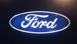 <p>The Ford Motor Company logo is seen on a wall at the Qatar International Motor Show in Doha, January 27, 2012. REUTERS/Fadi Al-Assaad</p>