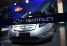 <p>A model stands besides a General Motors (GM) Chevrolet Volt car during India's Auto Expo, in New Delhi January 6, 2012. REUTERS/Adnan Abidi</p>