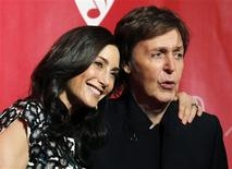 <p>Paul McCartney (R) and his wife Nancy Shevell (L) pose at the 2012 MusiCares Person of the Year tribute honoring McCartney in Los Angeles, February 10, 2012. REUTERS/Danny Moloshok</p>