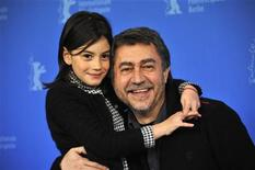 <p>Director Antonio Chavarrias and cast member Magica Perez pose during a photocall to promote the movie 'Dictado' at the 62nd Berlinale International Film Festival in Berlin February 11, 2012. REUTERS/Morris Mac Matzen</p>