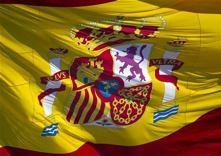 A Spanish flag flies in Madrid's Plaza Colon February 15, 2012. REUTERS/Paul Hanna