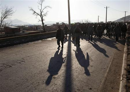 Afghan police march towards protesters during clashes in Kabul February 24, 2012. REUTERS/Ahmad Masood