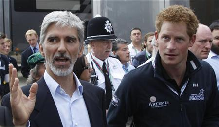 Britain's Prince Harry walks with former Formula One driver Damon Hill (L) after arriving to watch the British F1 Grand Prix at Silverstone, central England July 10, 2011. REUTERS/Leonhard Foeger