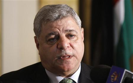 Jordan's Prime Minister Awn Shawkat Al-Khasawneh attends a news conference in Tripoli in this February 7, 2012 file photo. Khasawneh resigned on April 26, 2012, barely six months after he was asked to form a government in response to protests calling for faster political reforms in the kingdom. State television said King Abdullah accepted Khasawneh's resignation. REUTERS/Anis Mili/Files