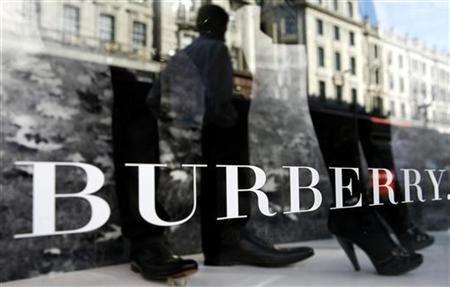 A mannequin is displayed in a window of Burberry's in central London July 15, 2008. REUTERS/Alessia Pierdomenico