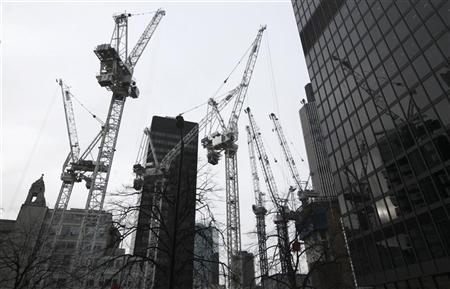 Cranes are seen on a construction site in The City of London February 14, 2012. REUTERS/Olivia Harris