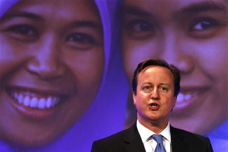Prime Minister David Cameron speaks at the London Summit on Family Planning in central London July 11, 2012. REUTERS/Suzanne Plunkett