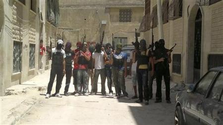 Syrian rebel fighters pose for a picture in Hama July 20, 2012. REUTERS/Shaam News Network/Handout