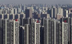 <p>Wuhan, dans la province de Hubei.Confrontée à un ralentissement de sa croissance, tombée à un plus bas de trois ans, l'économie chinoise semble avoir appuyé sur l'accélérateur avec une hausse de l'investissement dans les infrastructures et de la production industrielle revenue à un plus haut de cinq mois. /Photo d'archives/REUTERS</p>