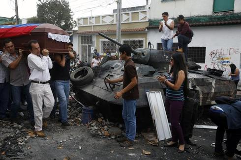 Protests and a funeral in Venezuela