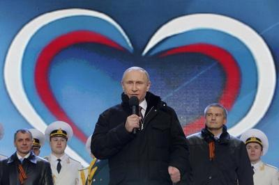 Putin signs Crimea treaty
