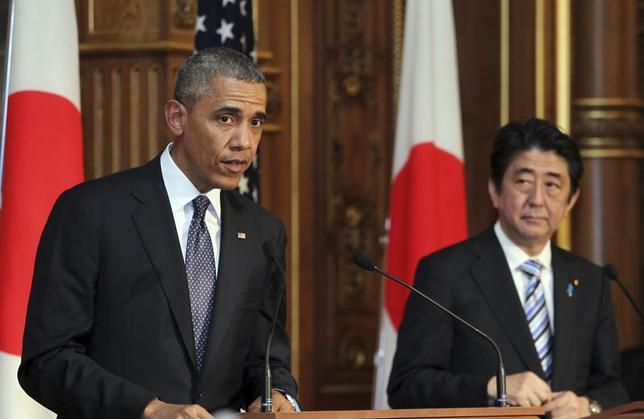 U.S. President Barack Obama (L) attends a news conference with Japanese Prime Minister Shinzo Abe (R) at the Akasaka guesthouse in Tokyo April 24, 2014. Obama used a state visit to Japan on Thursday to try to reassure Asian allies of his commitment to ramping up U.S. engagement in the region, despite Chinese complaints that his real aim is to contain Beijing's rise. REUTERS/Junko Kimura-Matsumoto/Pool (JAPAN - Tags: POLITICS) - RTR3MEF9