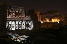 """A projection reconstructs parts of the Forum of Augustus, including the pavement, as it probably was 2,000 years ago in ancient Rome April 21, 2014  Rome, a city that thinks in millennia, is going through a bout of """"Augustus fever"""" to mark the 2,000th anniversary of the death of its first emperor, who left his mark on Rome and Western civilisation like few others.     REUTERS/Alessandro Bianchi"""