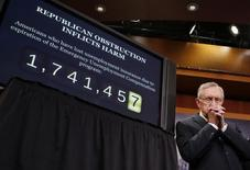 U.S.Senate Majority Leader Harry Reid pauses before speaking to members of the media ahead of the Senate vote on renewing unemployment benefits for millions of Americans, on Capitol Hill in Washington February 6, 2014.    REUTERS/Larry Downing