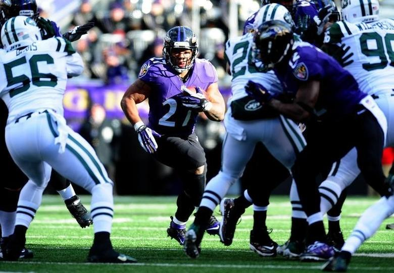 Nov 24, 2013; Baltimore, MD, USA; Baltimore Ravens running back Ray Rice (27) runs with the ball against the New York Jets in the first half at M&T Bank Stadium. Mandatory Credit: Evan Habeeb-USA TODAY Sports