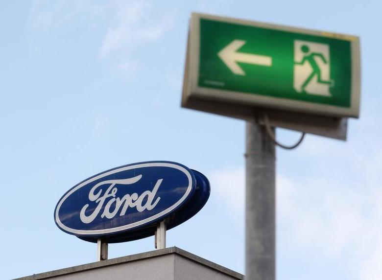 The Ford logo is pictured on the rooftop of Austria's Ford head branch in Vienna March 19, 2013. REUTERS/Heinz-Peter Bader/Files