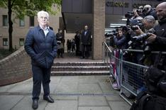British publicist Max Clifford poses for the media as he arrives at Southwark Crown Court in London May 2, 2014.  REUTERS/Neil Hall