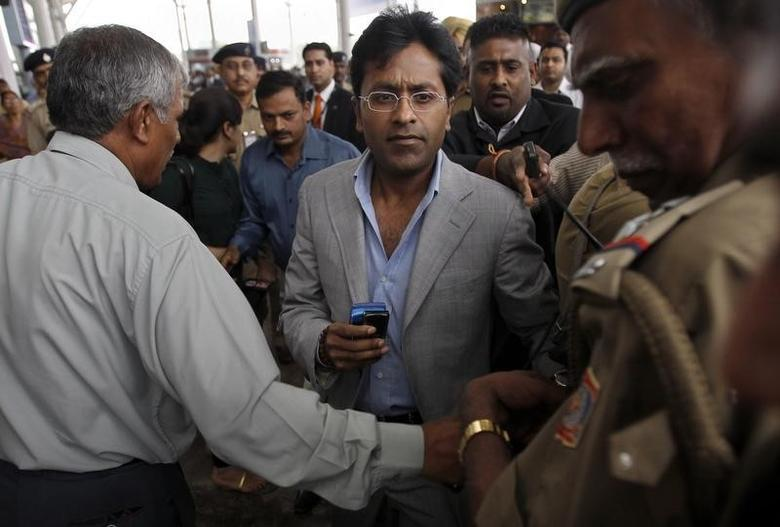 Lalit Modi, former chairman of Indian Premier League (IPL), leaves an airport in New Delhi April 28, 2010. REUTERS/Adnan Abidi/Files